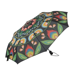 "What a unique item! Designed in Poland this beautiful umbrella features a Polish wycinanki paper cut design. Specially reinforced frame and a polyester folk print cover. Large 41"" - 105cm dish diameter with a 24"" - 61cm long handle.. Collapses to a very c"