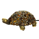 This beautiful turtle lamp has a cast bronze base.  The turtle shell is made from lead and imbedded with natural Polish amber pieces.  Small light in the inside.