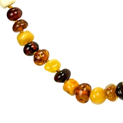 Lovely necklace composed of cherry, custard, light and dark honey amber. Oval amber bead size approx 6mm and smaller.  Gold colored cord w/ knot between each bead.  Gold plated silver claw clasp closure.