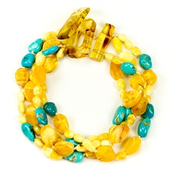 Bozena Przytocka is a designer of artistic amber jewelry based in Gdansk, Poland. Here is a beautiful example of her ability to blend amber and turquoise to create a stunning bracelet.