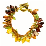 Bozena Przytocka is a designer of artistic amber jewelry based in Gdansk, Poland. Here is a beautiful example of her ability to blend a variety of amber shapes and peridot to create a stunning single strand bracelet.  Please note that the amber is a lit