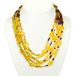 Bozena Przytocka is a designer of artistic amber jewelry based in Gdansk, Poland. Here is a beautiful example of her ability to blend amber, amethyst and peridot  to create a stunning necklace.