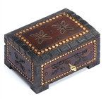 Chest style box with deep carved border and floral design accented with metal inlay. Lock and key.