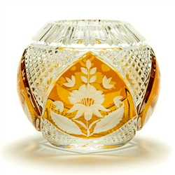 This is genuine Polish hand-cut leaded crystal with a floral design.  Amber colored background.
