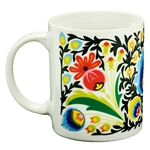 This very colorful folk design mug comes from the town of Lowicz, Poland. The wrap-a-round scene features two roosters and a floral design. Hand wash only.