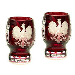 Genuine brilliant Polish 24% lead ruby red crystal hand cut with an engraved Polish Eagle and the word Polska on the front and a pinwheel design on the reverse.  Set of 2.