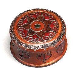 Handcarved and brass inlaid swirls create a flower-like pattern. Sides are carved as well.