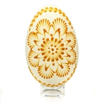 "This beautifully designed egg is ""painted"" with pure beeswax using the ""drop pull"" technique.  The wax design is left on the egg.