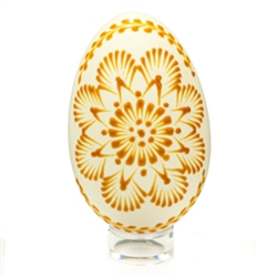"This beautifully designed egg is ""painted"" with pure bees wax using the ""drop pull"" technique.  The wax design is left on the egg.