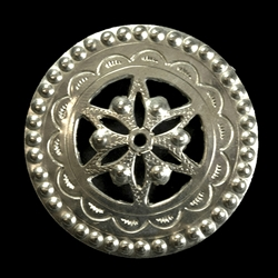 This Highlander pin is normally worn in the center of the man's shirt. Hand worked from metal with intricate detailing by one master artisan in Bukowina near Zakopane. The workmanship is exquisite and the detail so rich these decorations have become co