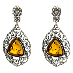 Triangular shaped honey amber inside an ornate Sterling Silver filigree design. Stylish and unique earrings.
