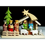 The Holy Family and in particular the Nativity is a popular theme in Polish folk art.  Composed of natural and hand painted wooden pieces. Easy assembly of manger, fence and tree which are pegged, no tools required.  Some base curvature is to be expected.