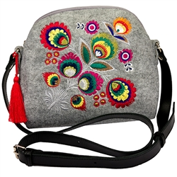 A small neat purse made of felt, which is characterized by high durability, as well as a robust leather strap with adjustable length. Despite the small size this handbag has a surprising capacity. The main decoration is a colorful embroidered Lowicz