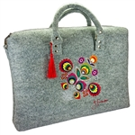 Large handbag made of stiff light grey felt, which is characterized by high durability. The main decoration is a colorful embroidered Lowicz flower - an original design by Farbotka, inspired by Polish folk culture. Includes an adjustable, detachable strap