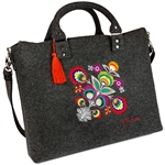 Large handbag made of dark grey felt, which is characterized by high durability. The main decoration is a colorful embroidered Lowicz flower - an original design by Farbotka, inspired by Polish folk culture. Includes an adjustable, detachable strap