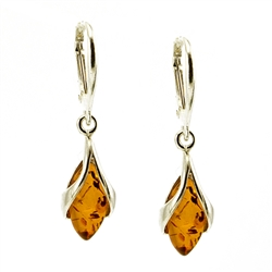 Honey amber wrapped in Sterling Silver teardrops. Stylish and unique.Amber is soft, only slightly harder than talc, and should be treated with care.
