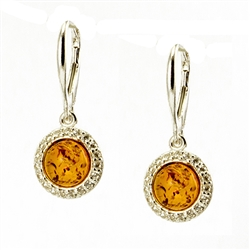 Beautifully designed classic silver setting for these honey shaded amber stones.  Sterling silver open hooks.
