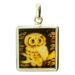 "Beautifully carved owl in rectangular shaped amber pendant framed in sterling silver. Size approx. .8"" x 1.25"" - 2.3cm x 3.5cm (including finding."