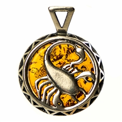 Hand made Cognac Amber Scorpio pendant with Sterling Silver detail. October 23 - November 21.