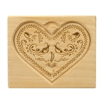 Solid beech wood hand carved mold featuring a traditional heart shape folk design.  This mold comes from the gingerbread museum in Torun, Poland.  These types of wooden molds are used to create gingerbread and cookie designs.