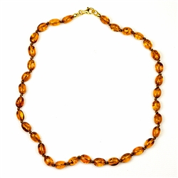 Lovely necklace composed of cognac colored amber. Gold colored cord w/ knot between each bead. Perfect size for children over three. Definitely not intended for children 3 or younger due to the small parts and choking hazard.