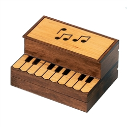 Burned and stained piano design, upright musical notes area opens and below the keys this box opens for 2 compartments.
