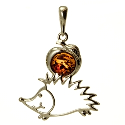 Hand made with Sterling Silver detail.  Our cute little silver hedgehog is making off with an Amber apple!