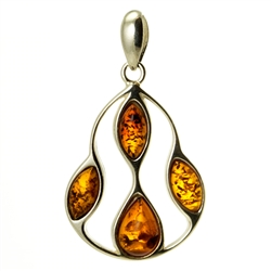 Sterling Silver Filigreee Pendant With Honey Amber. Amber (Bursztyn in Polish) is fossilized tree sap that dates back 40 million years. It comes from all around the world, but the highest quality and richest deposits are found around the Baltic Sea