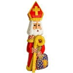 "This St. NIcholas was carved and painted by Polish folk artist Andrzej Cichon from Kutno. Mr Cichon signs his work by carving a stylized version of his initials on the bottom of this carving. The body is carved from one block of wood (approx 15.5"" x 5.5"""