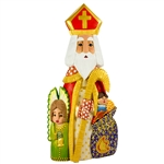 "This St. Nicholas was carved and painted by Polish folk artist Andrzej Cichon from Kutno. Mr Cichon signs his work by carving a stylized version of his initials on the bottom of this carving. The body is carved from one block of wood (approx 16.25"" x 7"" x"