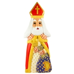 "This St. Nicholas was carved and painted by Polish folk artist Andrzej Cichon from Kutno. Mr Cichon signs his work by carving a stylized version of his initials on the bottom of this carving. The body is carved from one block of wood (approx 16"" x 6"" x 2."