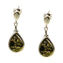 Artistic tear drop shaped silver earrings with a center of green colored amber.