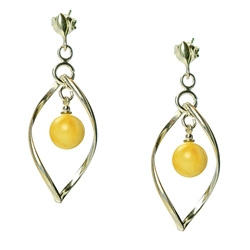 Custard amber balls suspended in artistic sterling silver.  Keep in mind that custard shades vary and contain streaks of both yellow and white.