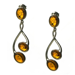 Honey amber drop earrings, with sterling silver post backs. Amber is soft, only slightly harder than talc, and should be treated with care.