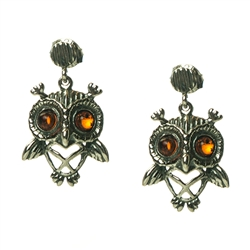 Charming sterling silver owl earrings with cognac amber eyes.