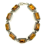 "9 rectangular shaped amber beads each set in a sterling silver frame. 7"" - 18cm long."