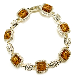 "7 square amber beads each set in a sterling silver frame. 7"" - 18cm long. Each amber square is approx 1cm."