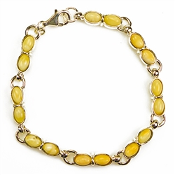"Fine 7"" - 18cm bracelet composed of milky oval Baltic Amber beads. Bead size 7mm long."