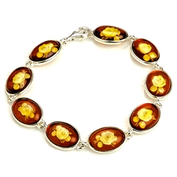 "9 beautiful oval amber cameo beads (carved roses) each set in a sterling silver frame. 7"" - 18cm long."