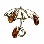 Adorable silver brooch with Baltic Amber oval stones. Amber (Bursztyn in Polish) is fossilized tree sap that dates back 40 million years.  It comes from all around the world, but the highest quality and richest deposits are found around the Baltic Sea.