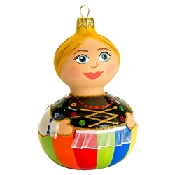 "This little dear is sure to be a real doll in your collection! Our 5"" tall Lowicz dancer ornament showcases Poland's craftsmanship at its finest. This unique glass ornament is masterfully painted with glittering accents to add an extra fantastical appeal."