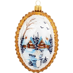Beautiful hand-painted winter scenes grace both sides of this unique medallion hand-crafted of glass in Poland. Picturesque cabins amidst snow-capped pines are awash in restful hues, of gold, blue and white. Adorned with accents of iridescent glitter