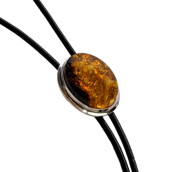 Beautiful black bolo tie with a large centerpiece of cognac amber set in a sterling silver casing.  Silver tipped ends.