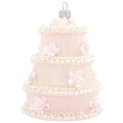 Serve up a delicious addition to any newlywed's tree with this wedding cake ornament! Crafted of glass in Poland, this beautiful cake is accentuated with beads and iridescent glitter. Commemorate that special day with our wedding cake ornament!