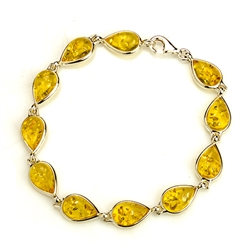 "10  tear drop shaped amber beads each set in a sterling silver frame. 7"" - 18cm long."