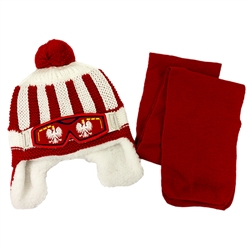 Handsome snow bonnet and scarf. Polish Eagle Faux Ski Goggles across the front.  Easy care acrylic knit fabric. Polyester lining. One size fits most.  Made in Poland.