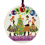 A colorful and light (but sturdy) laminated disc ornament featuring Polish carolers In Lowicz costumes.  Ready to hang with it's own ribbon hanger. Similar to a thin paper coaster approx 3ml thick.  Made in Poland