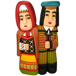 Cute Lowicz folk couple hand carved and painted by Master artist Andrzej Cichon from Kutno.  Mr Cichon signs his work by carving a stylized version of his initials on the bottom of this carving.
