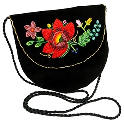 Hand beaded purse made from velvet. Fully lined. Extra long strap. Snap closure. Made in Lowicz, Poland.