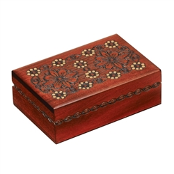 This beautiful box is decorated with a blossom design on the lid. Additional detailing around the sides of the box completes the piece. Handmade in the Tatra Mountain region of Poland.